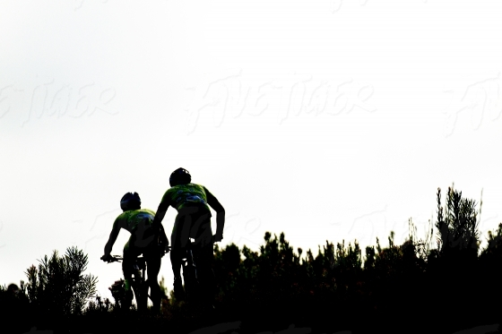 Silhouette of riders