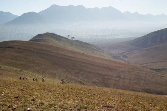 Mountain bikers climbing scenic mountains