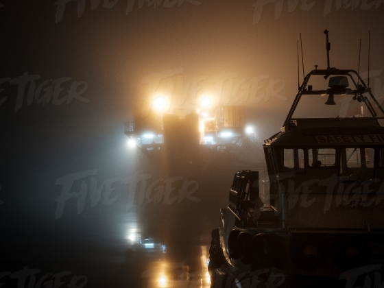 Eerie night harbour scene