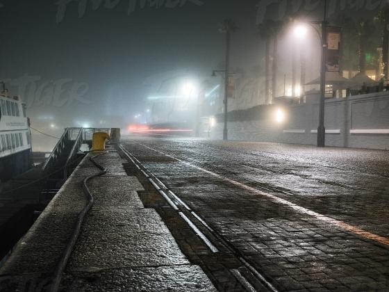 Eerie night harbour scene