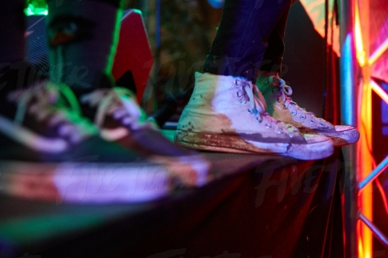 Detail of trendy shoes at a music festival