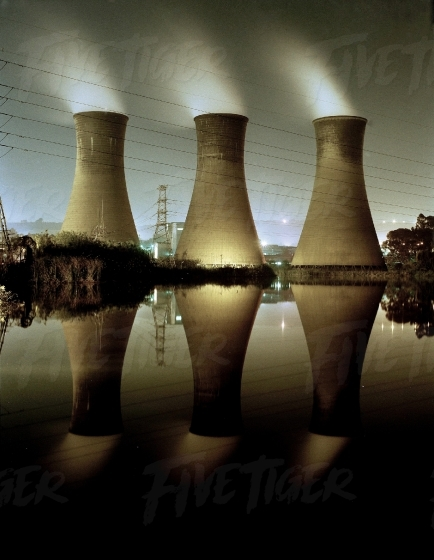 Reflection of cooling towers in a row
