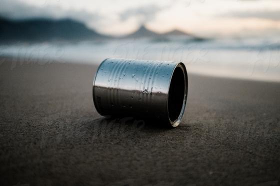 Tin on the beach