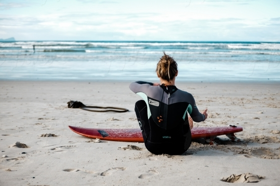 Young girl getting ready for a surf