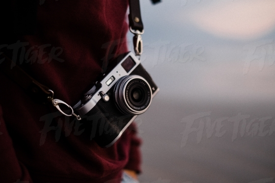 Camera with a leather strap