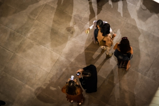 Top view of people drinking wine at an art exhibition