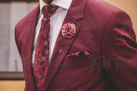 Well dressed gentleman in a stylish deep pink suit