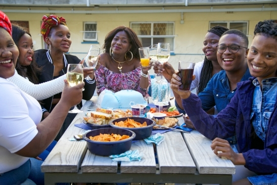 Group of friends together celebrating