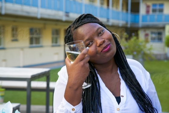 Woman posing with a glass of white wine