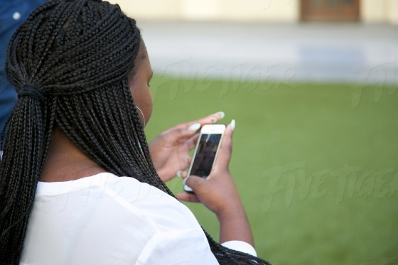 Girl with long braids texting