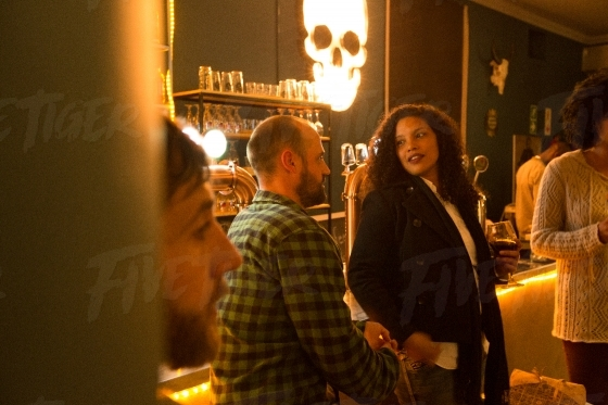 Attractive woman talking to a man at a trendy local bar