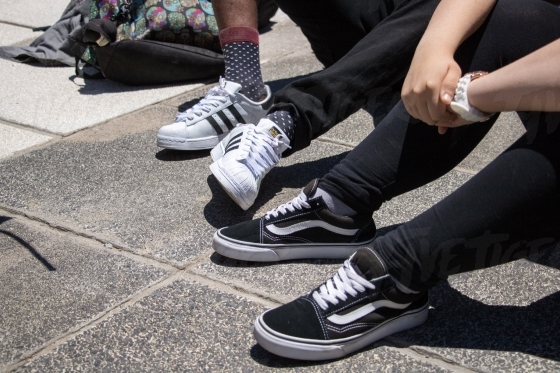 Kids on the pavement wearing trendy sneakers
