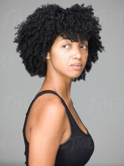 Studio portrait of beautiful young woman in a black tank top