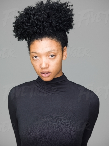 Studio portrait of a beautiful woman in a classic black polo neck