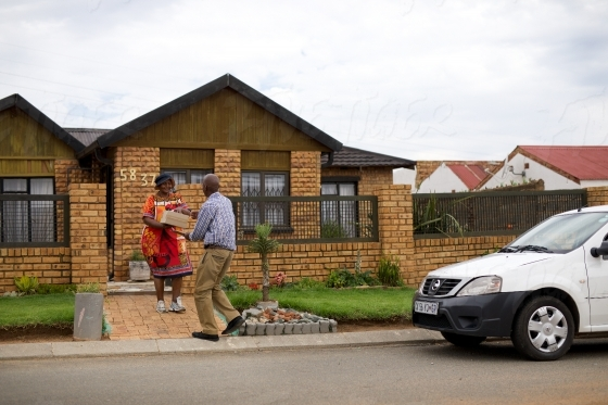 Soweto resident recieving a delivery at home