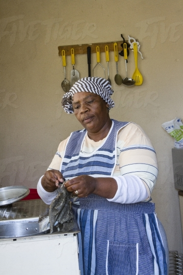 South African women in her kitchen at home