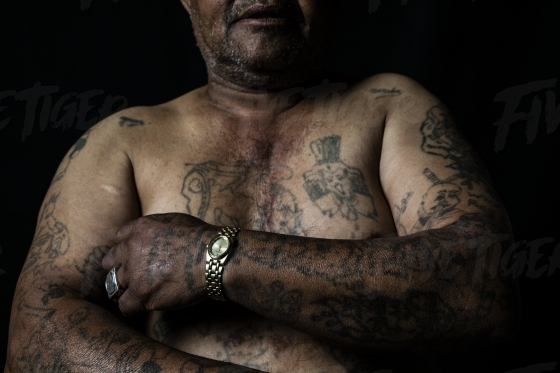 Man with gang member tattoos on his body