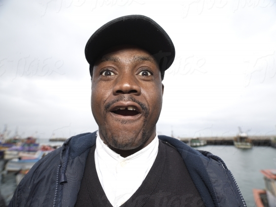 Portrait if surprised man at Kalk Bay Harbour