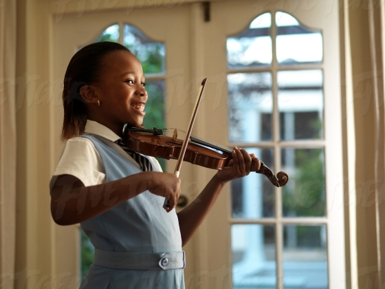 School girl pracising the violin