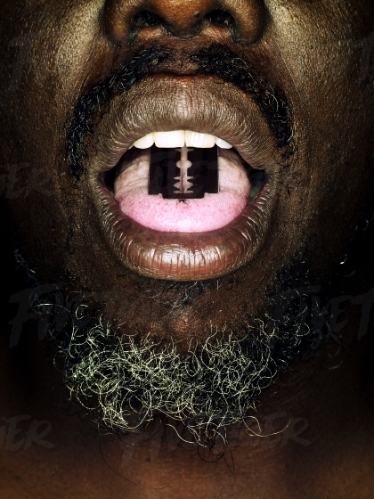 Prisoner with blade on his tongue