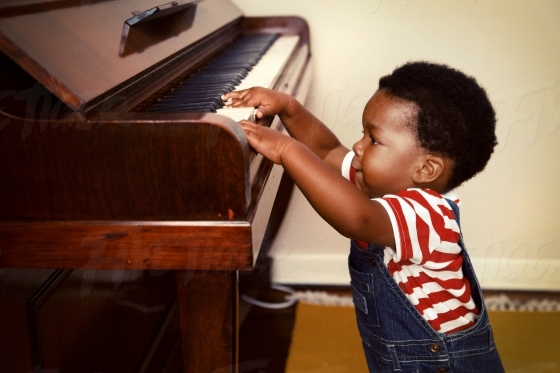 Young boy discovering the piano
