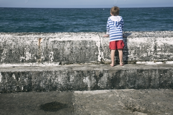 Little boy on the pier