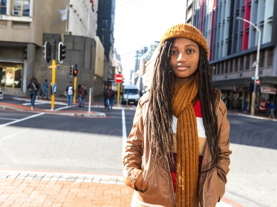 Young girl in brown leather jacket