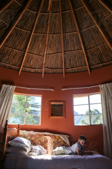 Relaxing on a bed in a hut