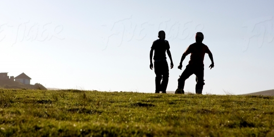 Silhouette of boys playng soccer