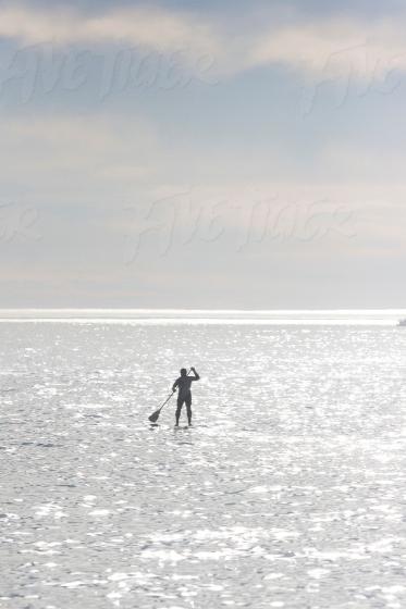 SUP boarding in the sea