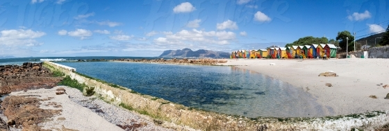 Panoramic image of the colourful huts on St. James beach
