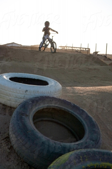Kid riding a BMX cycle